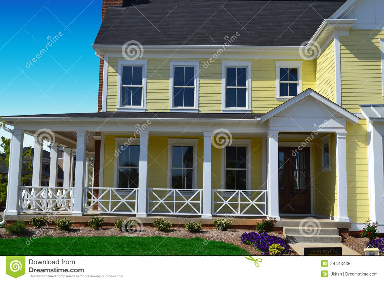 Yellow new england style home with porch stock image for New style houses
