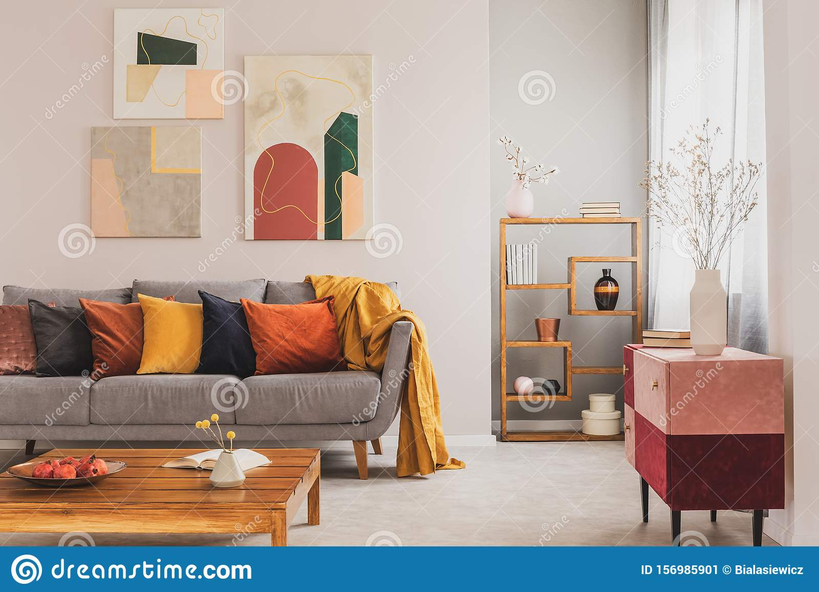 Yellow Orange Black And Brown Pillows On Comfortable Grey Scandinavian Sofa In Bright Living Room Interior With Abstract Stock Image Image Of Flat Chic 156985901