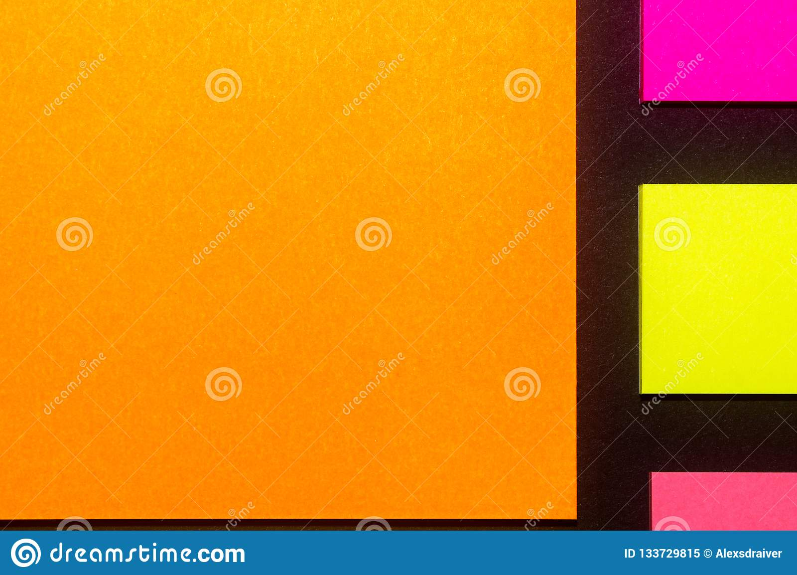 Yellow, orange and rose hue colorful office stickers on black paper. Office noteparer as reminder. Isolated on black paper.