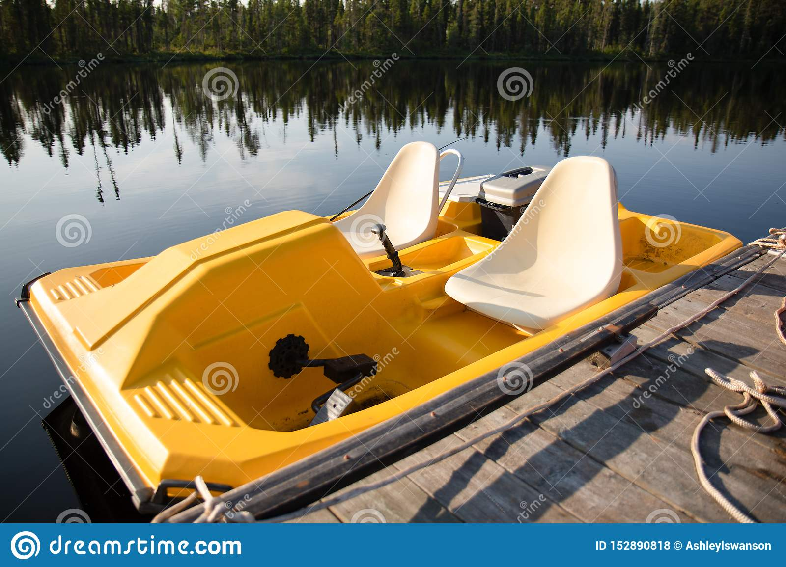 Yellow Paddle Boat In the Summer on a Lake