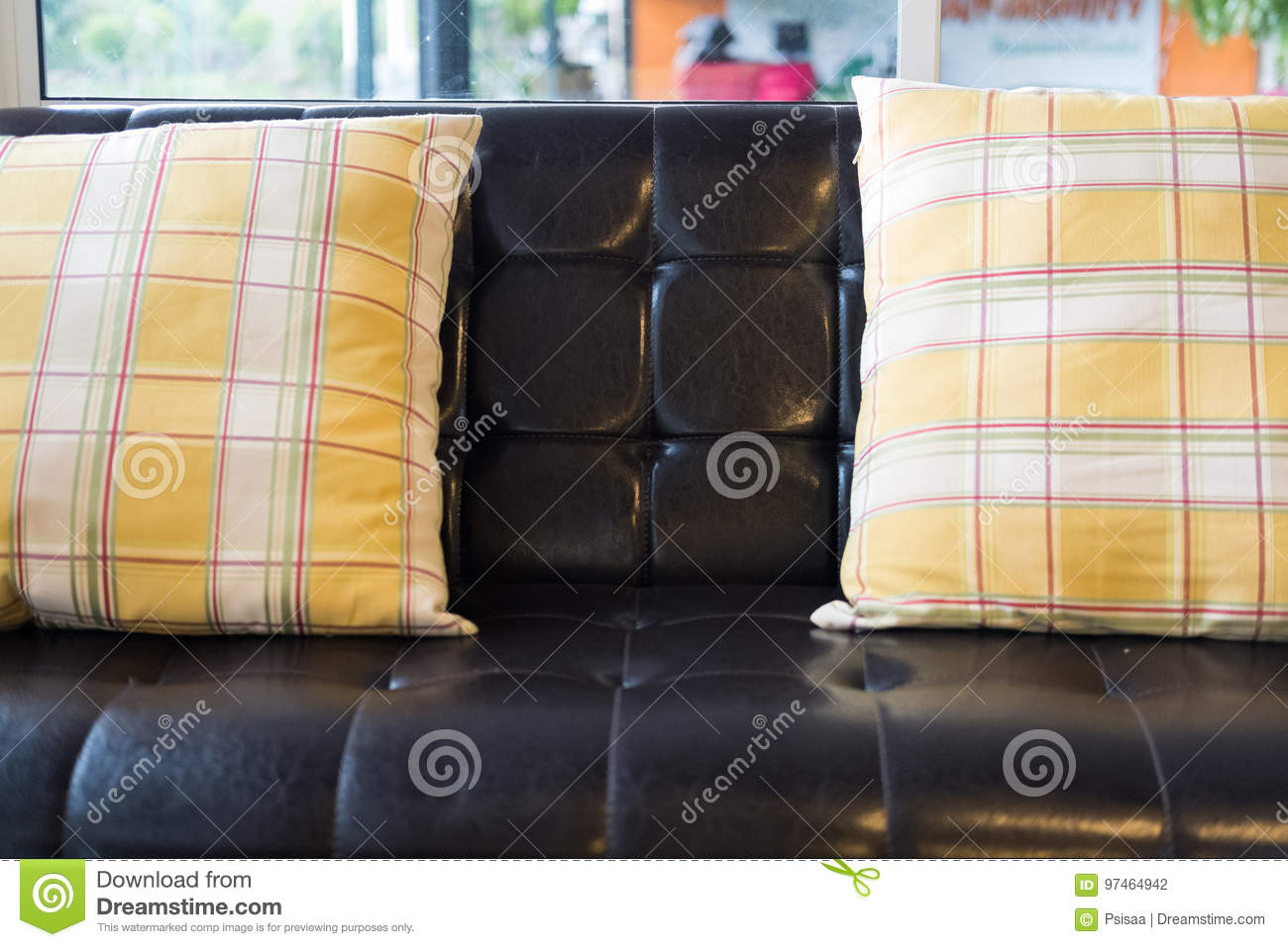 Yellow Pillow And Brown Leather Sofa Near Window At Restaurant O