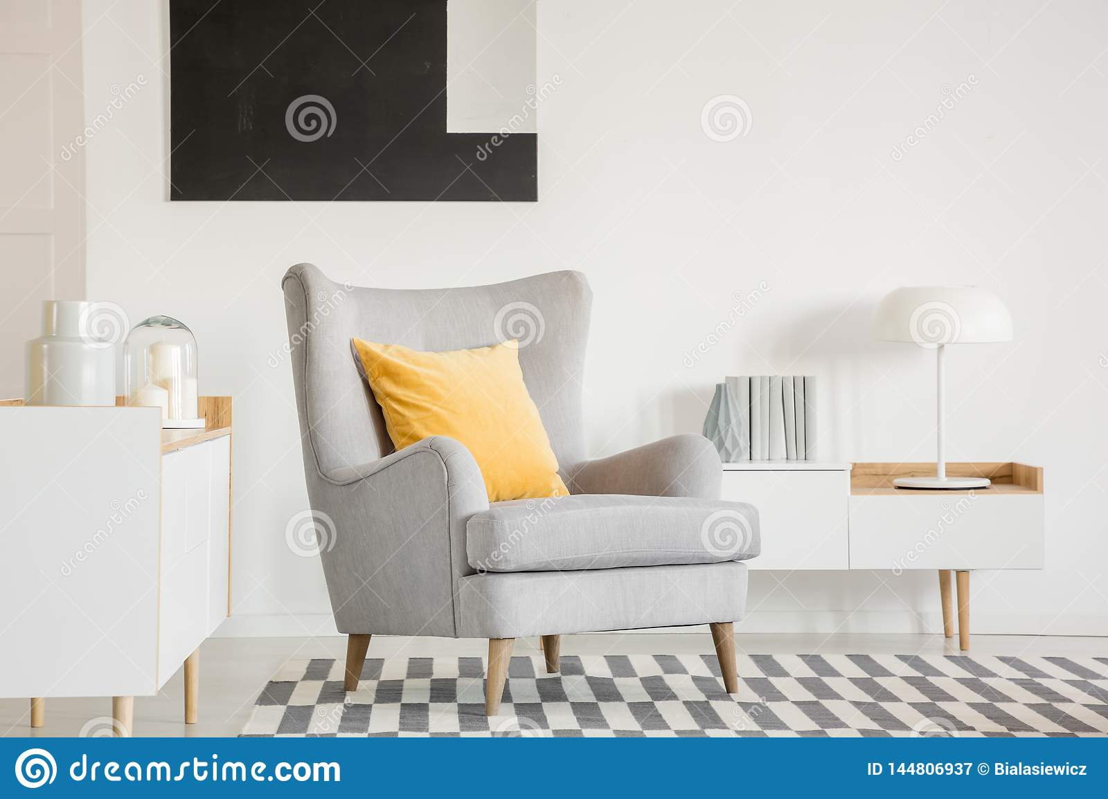 Pillow On Grey Armchair In Fashionable Living Room Interior ...