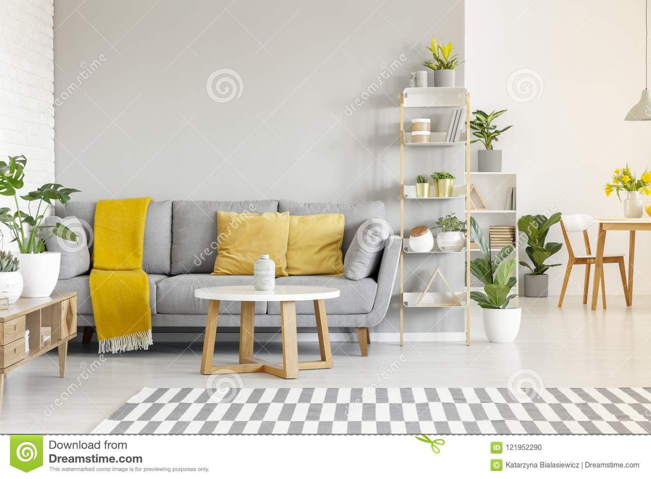 Yellow Pillows And Blanket On Grey Sofa In Modern Living Room In