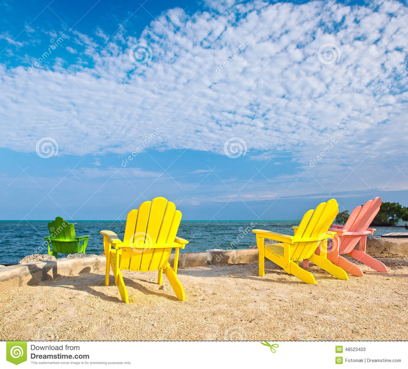 Yellow And Pink Colorful Lounge Chairs A Beach In Florida Stock Image