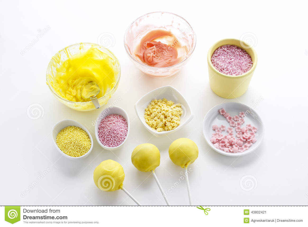 Decorate Cake Pops Sprinkles : Yellow And Pink Icing And Colorful Sprinkles Stock Photo ...