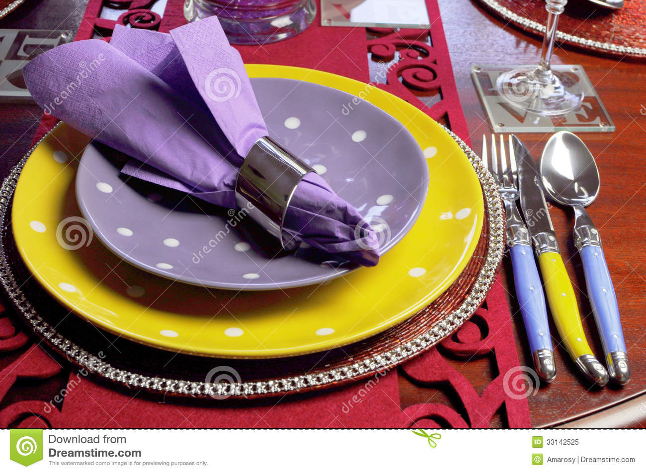 Yellow And Purple Table Place Setting Close Up Stock