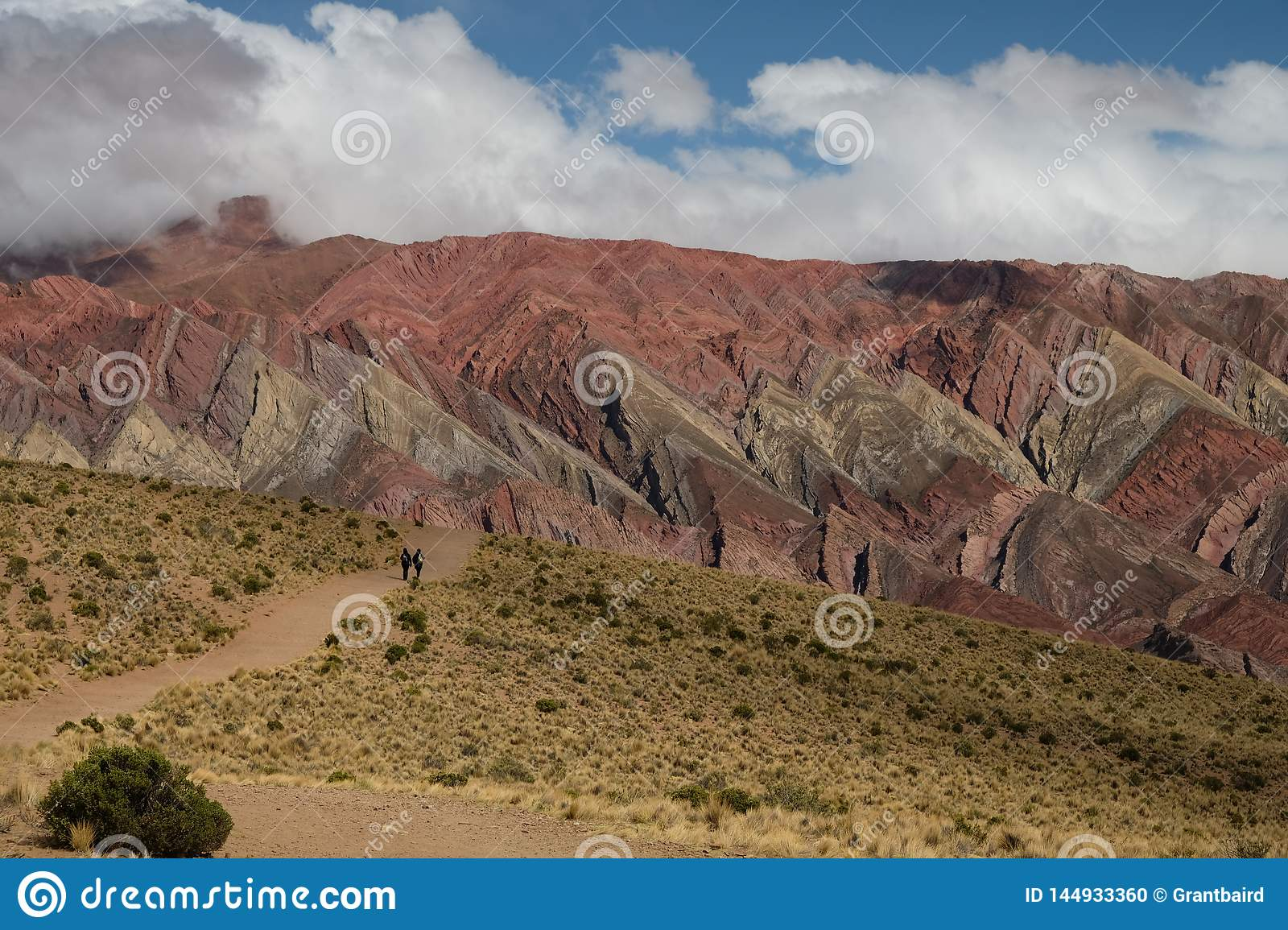 Rainbow mountains and valley in Humahuaca Argentina with hikers