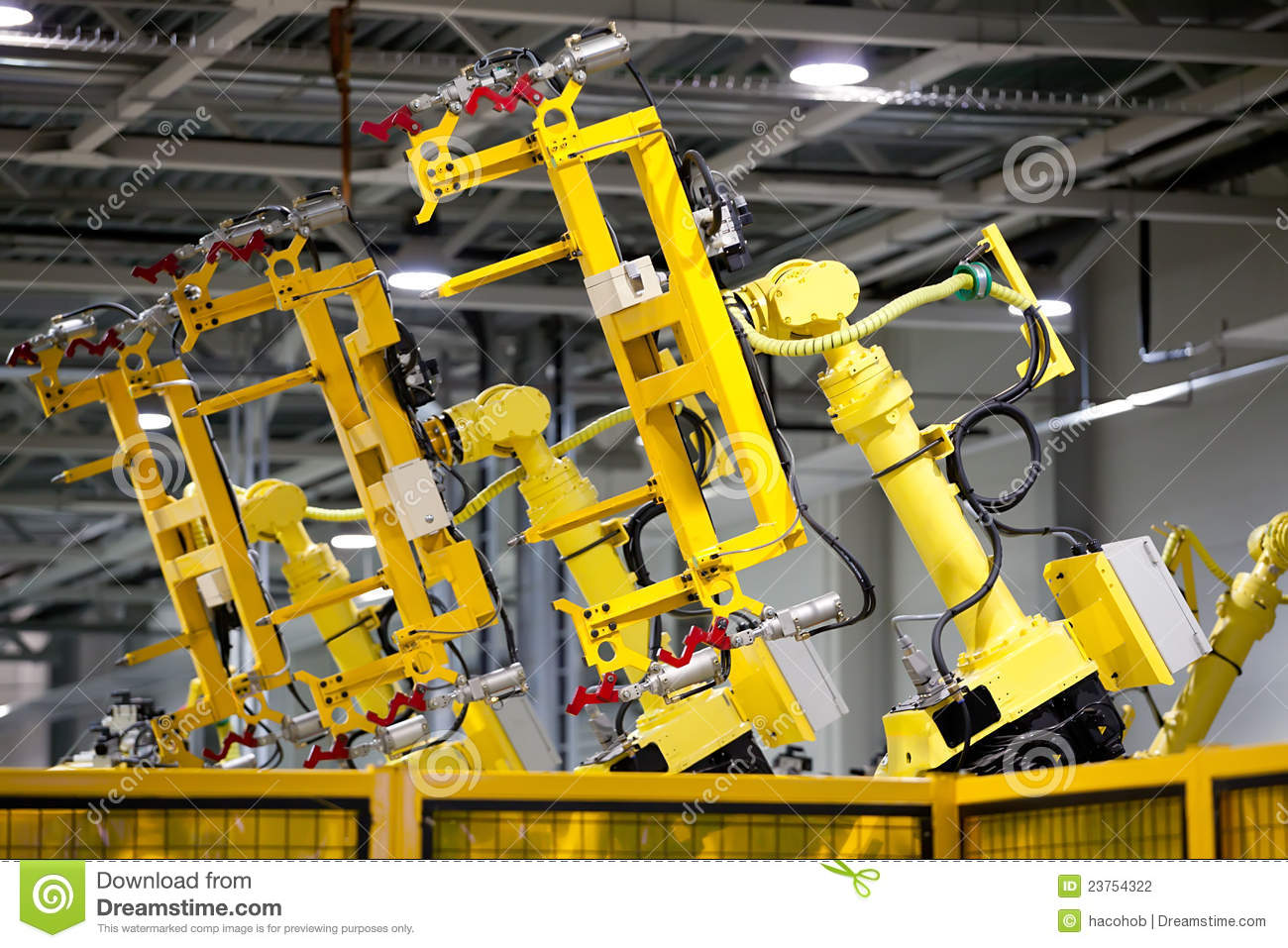 Yellow robots on a production line