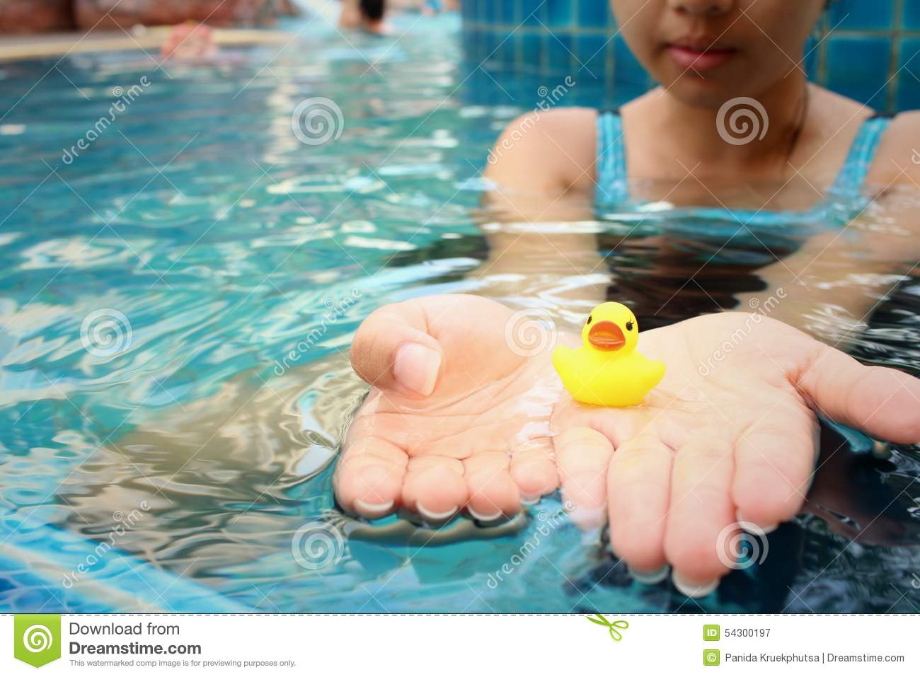 Rubber Swimming Pools : Yellow rubber duck in hands at swimming pool stock image