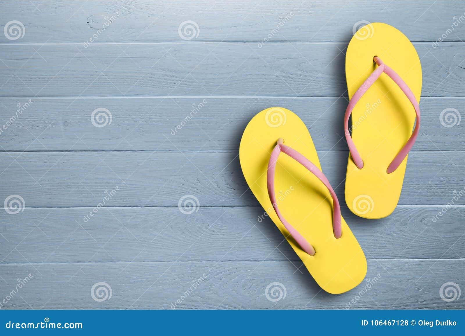 c4913c8ad571 Yellow rubber sandals flip flops on wooden stock photo image jpg 1300x957 Yellow  rubber sandals