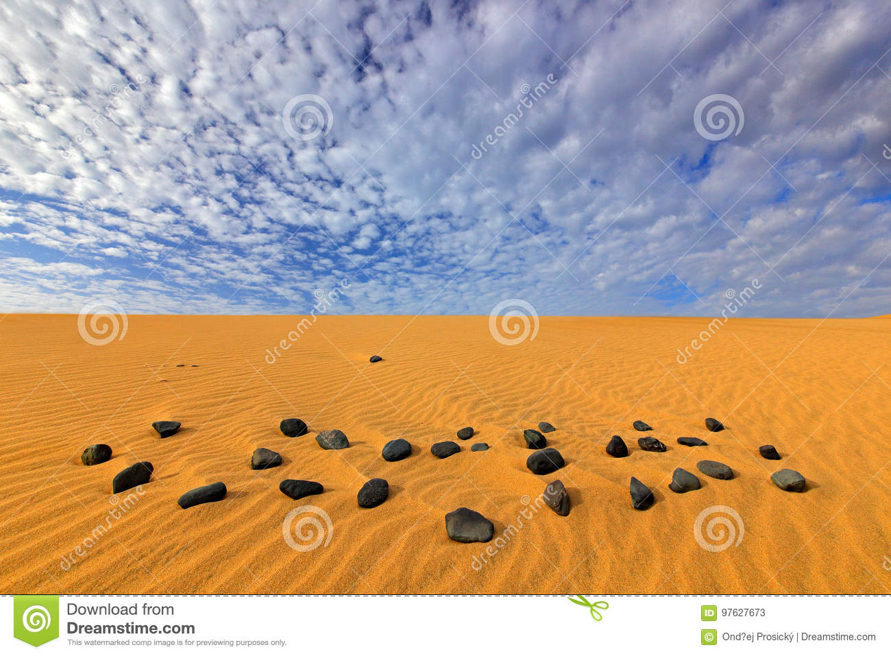 Yellow sand. Summer dry landscape in Africa. Black pebble stone.