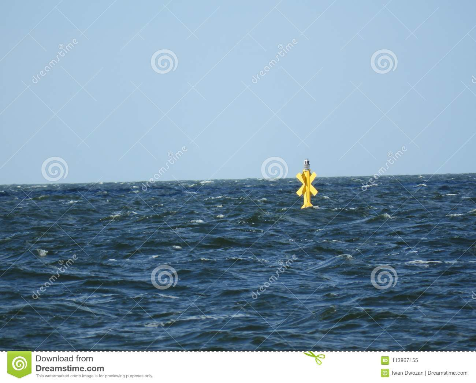 Yellow Sea Water Windmill Blue Sky Stock Image - Image of
