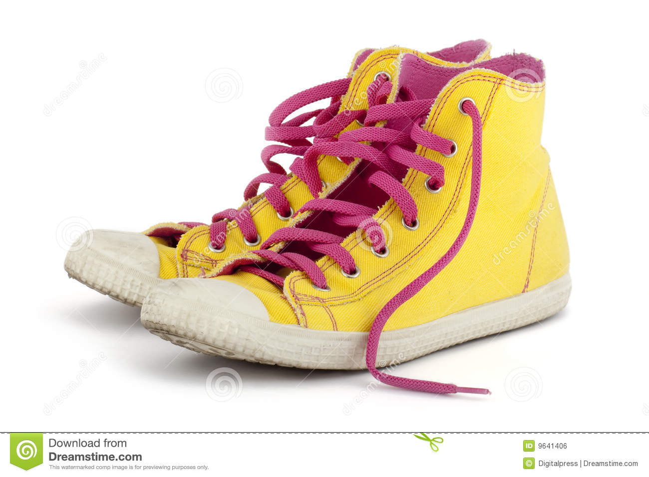 yellow shoes with pink shoelace royalty free stock image