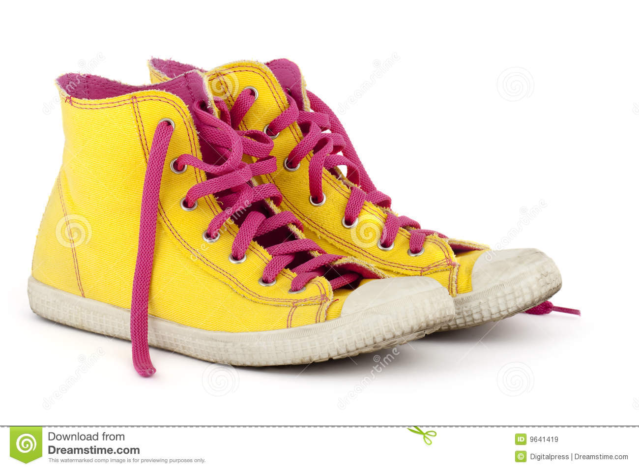 yellow shoes with pink shoelace royalty free stock images