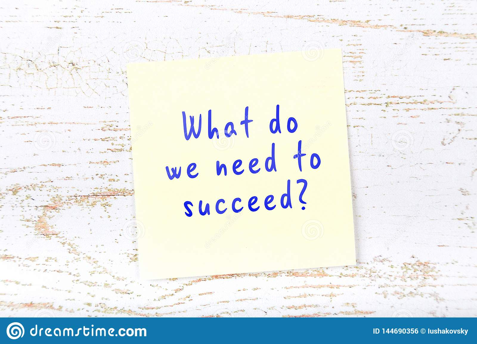 Yellow sticky note with handwritten text what do we need to succeed