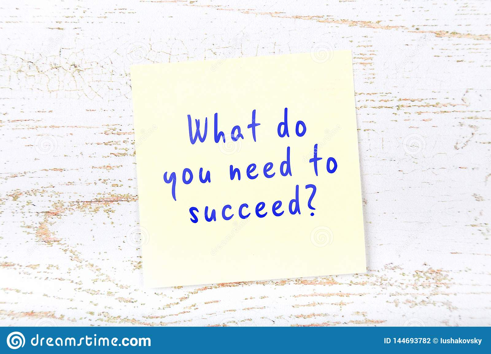 Yellow sticky note with handwritten text what do you need to succeed