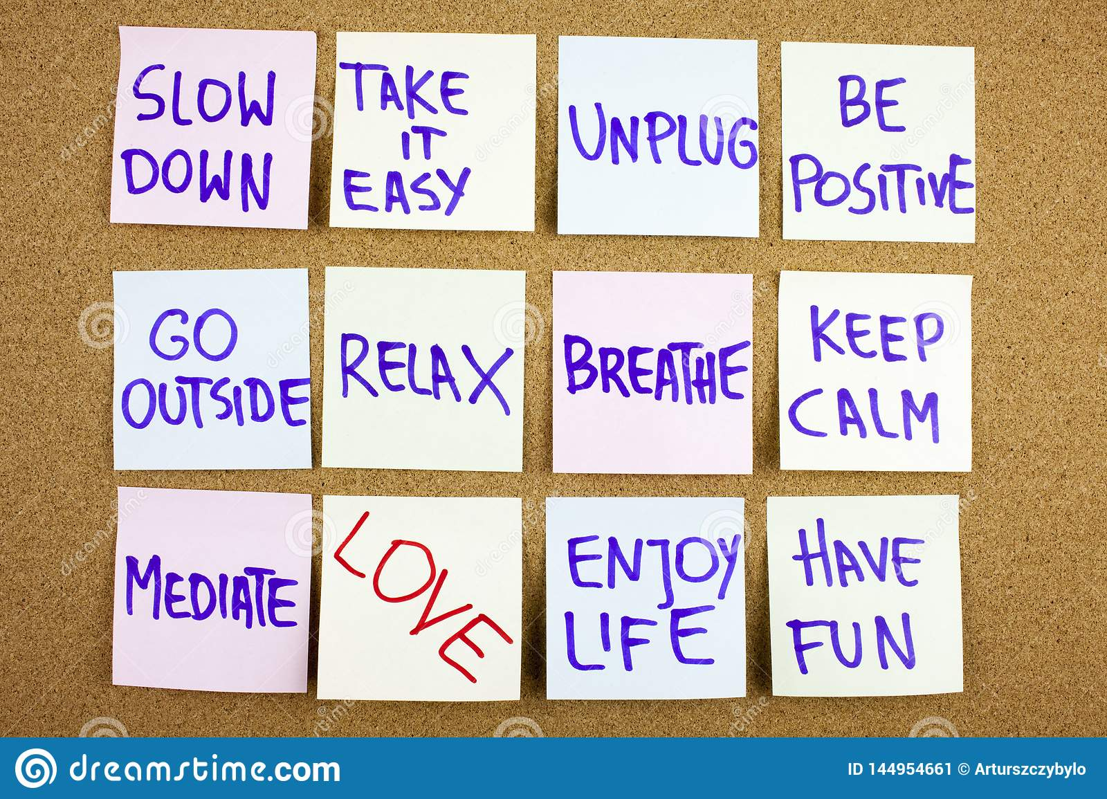 A yellow sticky note writing, caption, inscription Slow down, take ir easy be positive go outside relax breathe keep