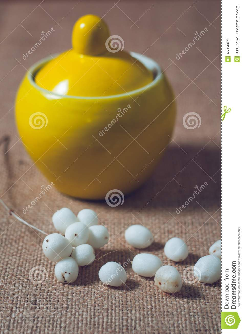 Yellow sugar bowls with lids - Yellow Sugar Bowl On A Table With White Balls