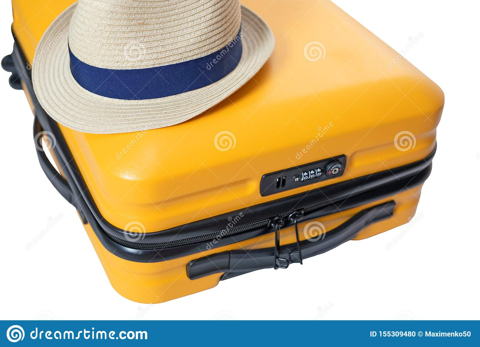 yellow suitcase with a combination lock with numbers 666 on it. Summertime - travel bag and straw hat on top