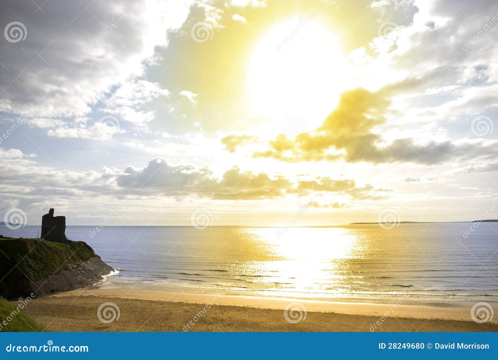 Yellow sun over the Ballybunion beach and castle
