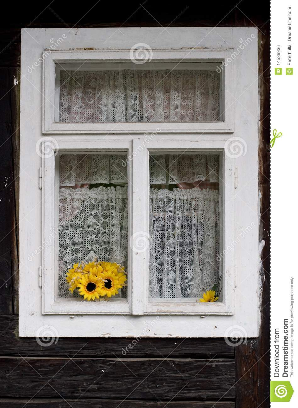 Yellow sunflowers in a window