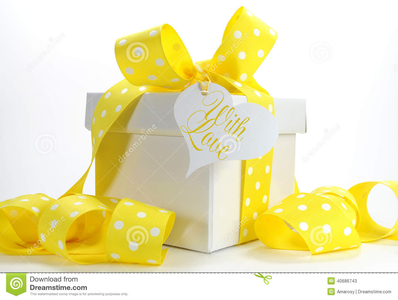 Yellow Theme Gift Box With Yellow Polka Dot Ribbon Stock Photo