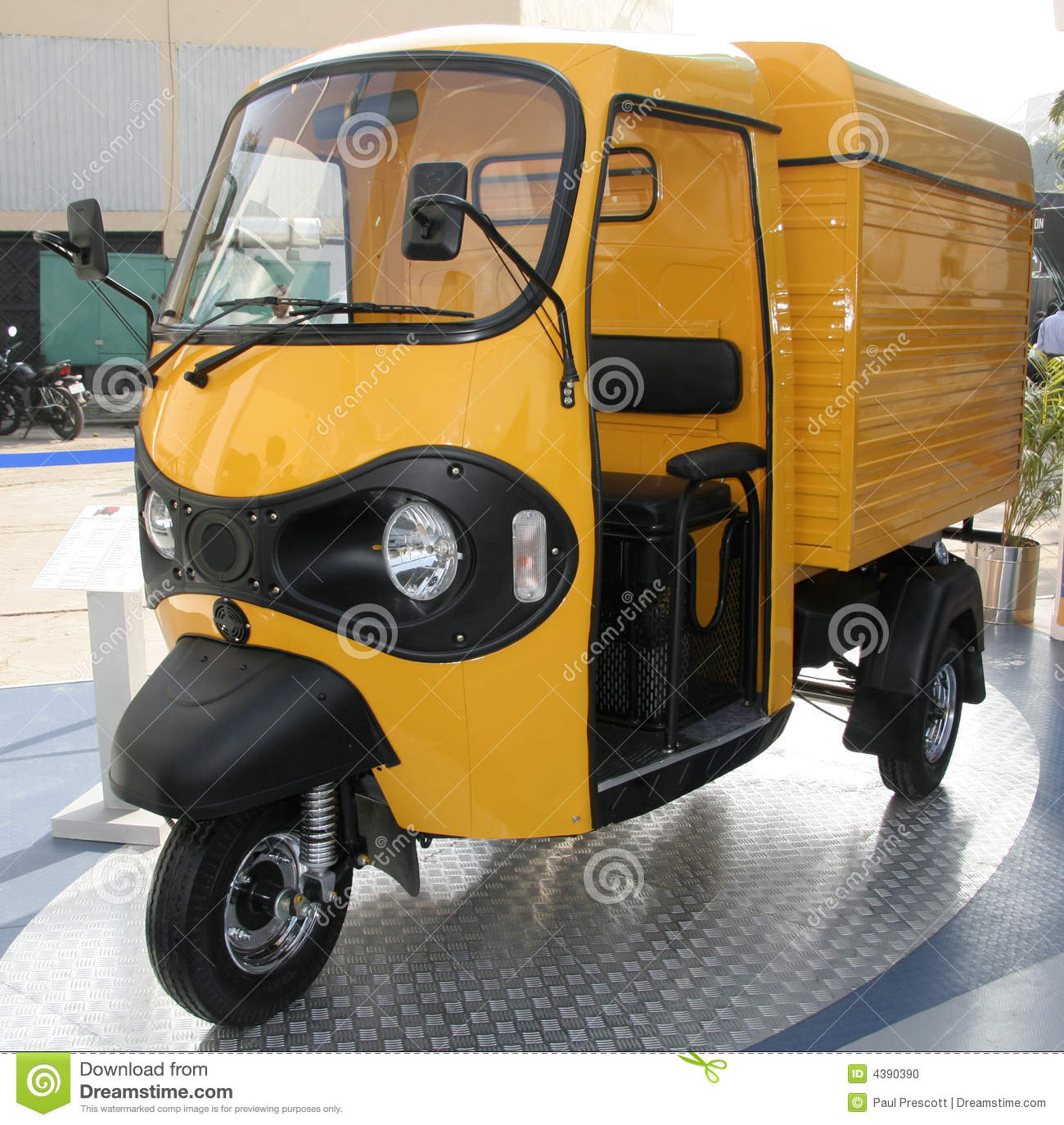 Yellow three wheeler pickup at
