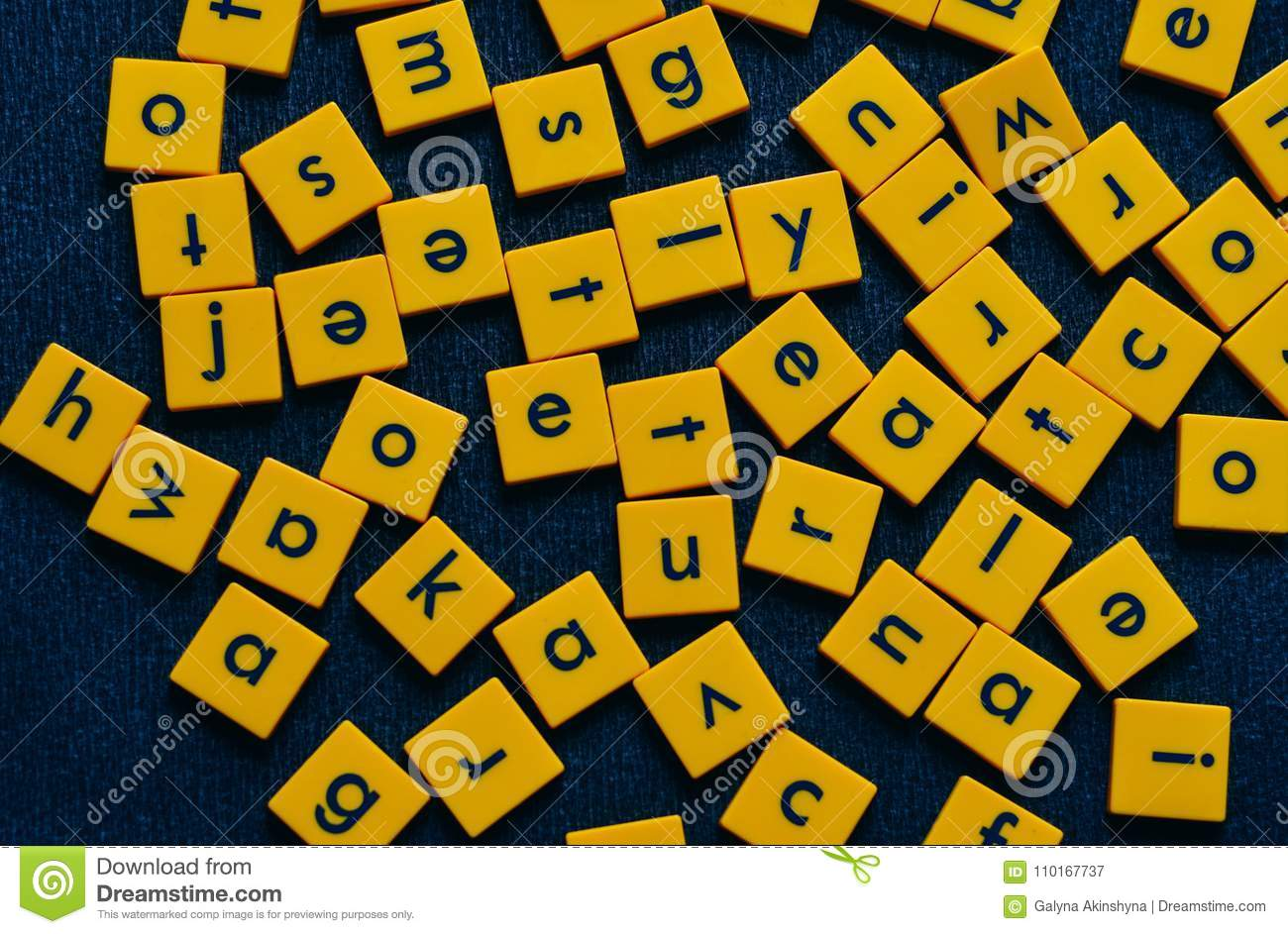 Yellow tiles with black letters on black background