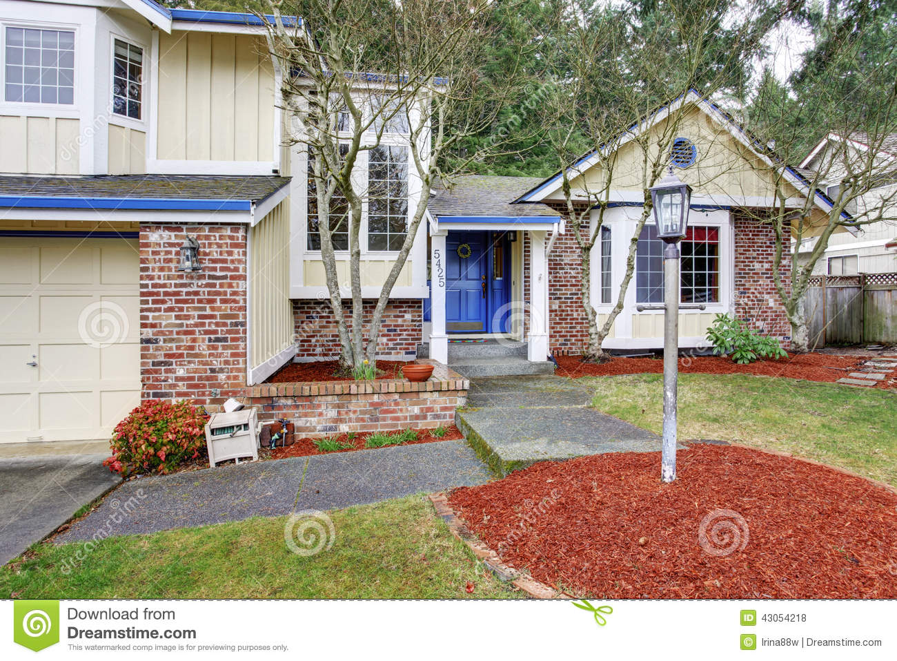 Yellow traditional northwest house with red brick stock for Yellow and red house