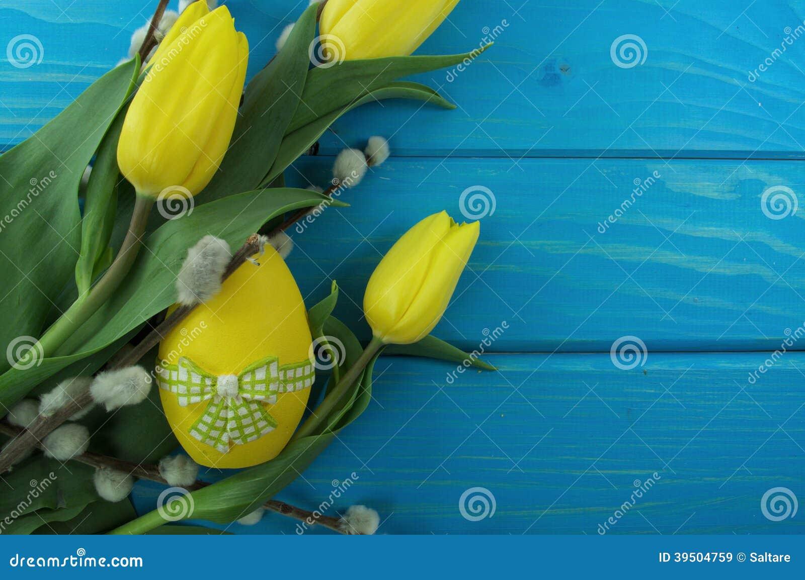 Yellow tulips and egg