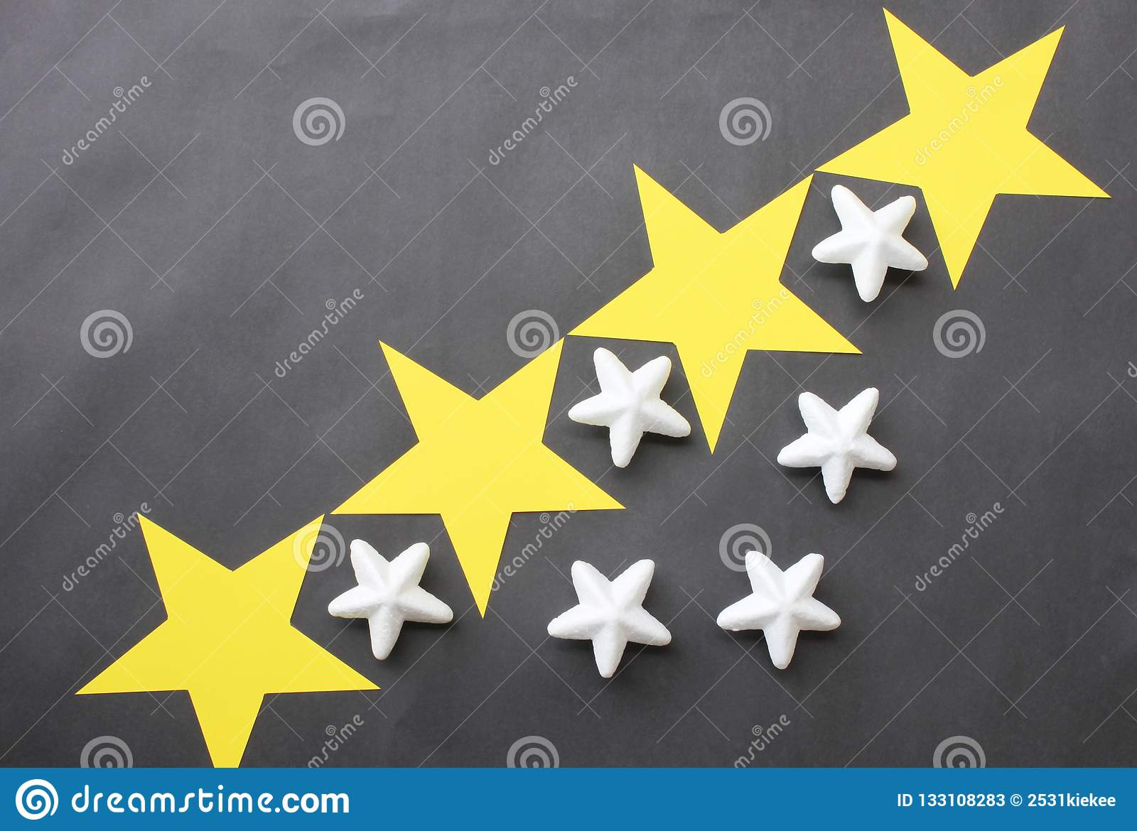 Yellow And White Stars Are Placed On A Black Background For Business