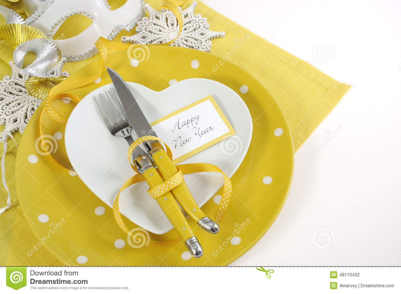 Yellow and white theme Happy New Year table setting