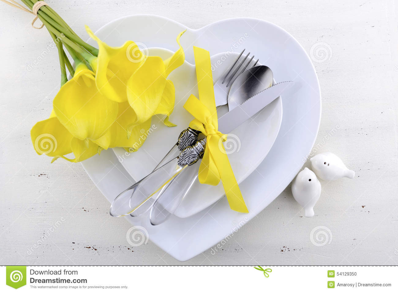 Yellow and white theme wedding table place setting.