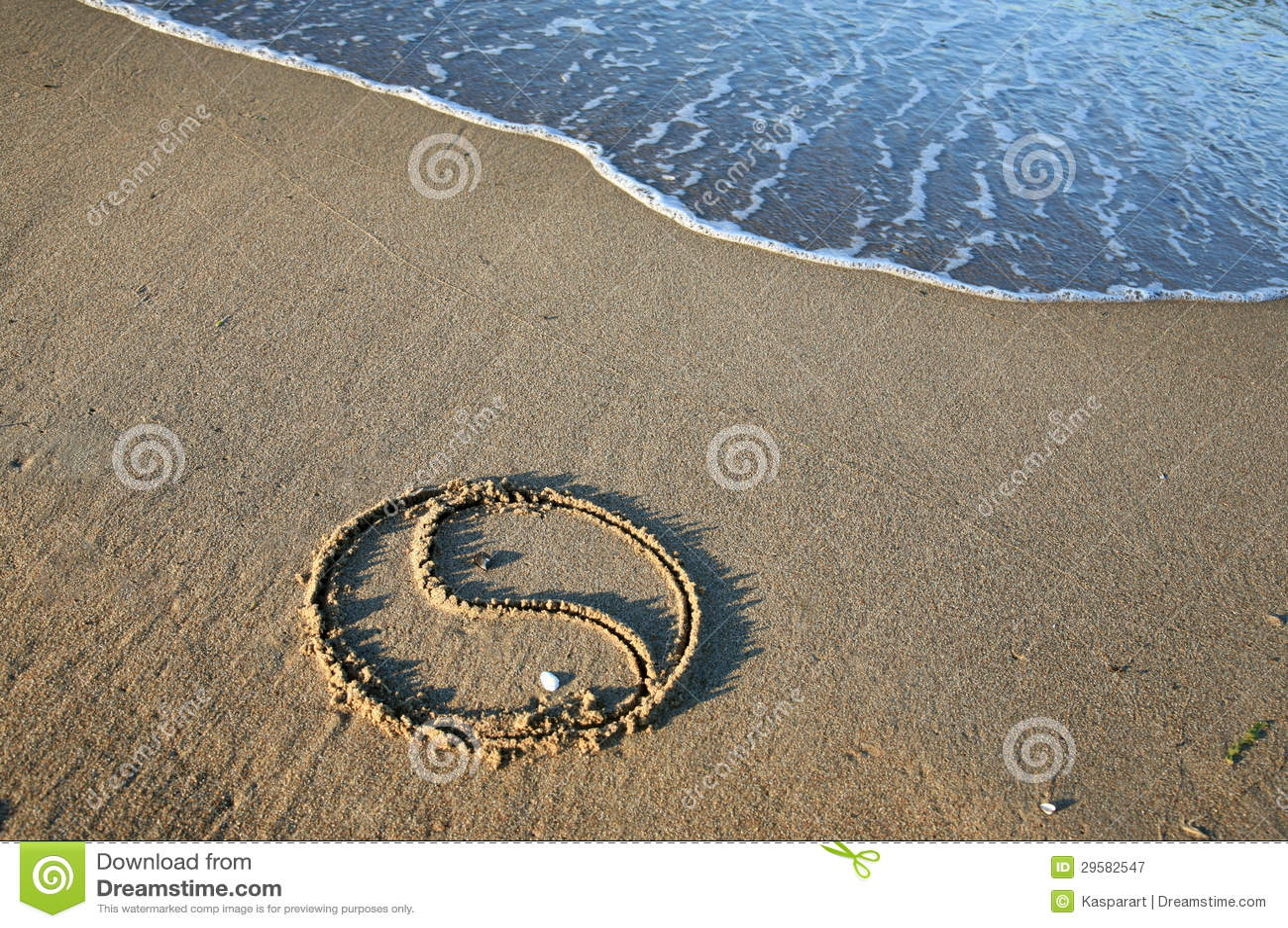 Yin Yang på stranden