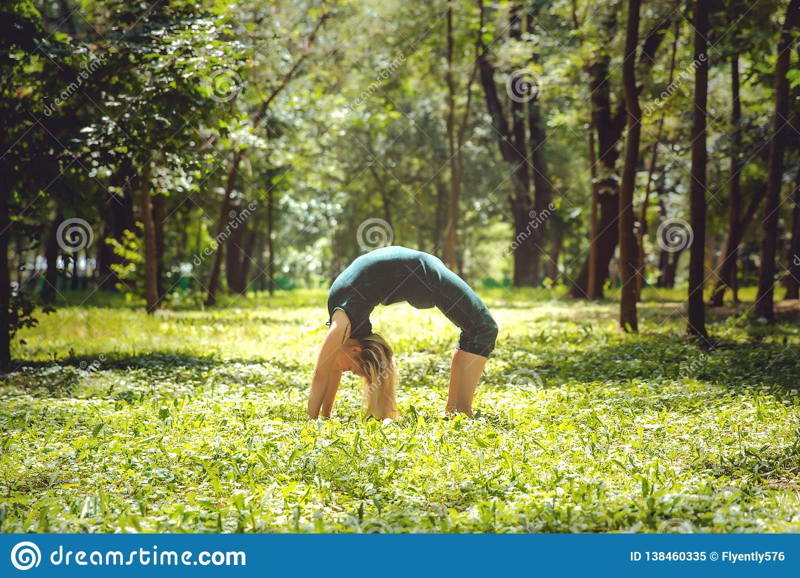 Urdhva Dhanurasana. Yoga Asanas In Nature. Yoga Poses Everyday