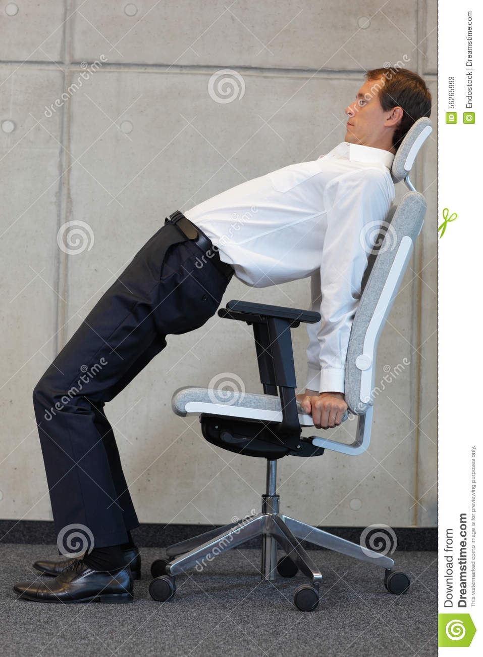 yoga on chair in office - business man exercising stock photo