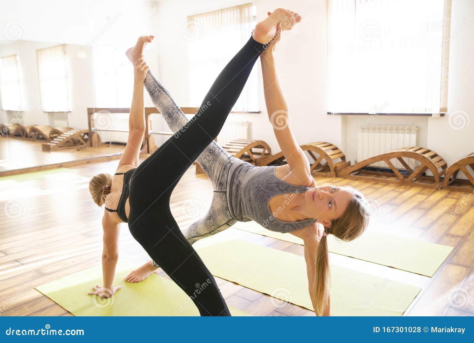Yoga Class Two Girls Doing Yoga Pose Wellness And Healthy Lifestyle Stock Photo Image Of Asana Beautiful 167301028
