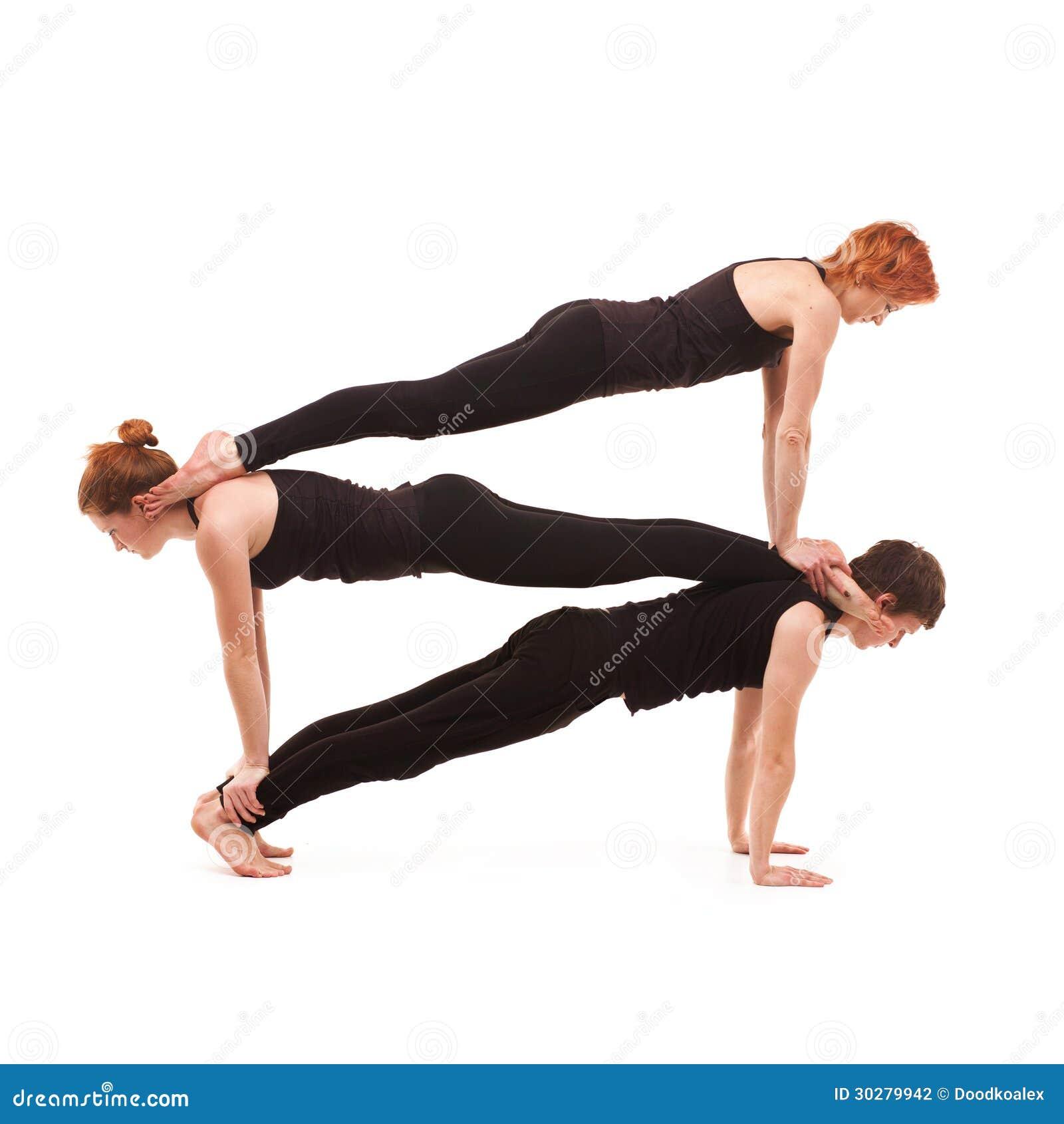 Yoga Del Grupo En Un Fondo Blanco Foto De Archivo