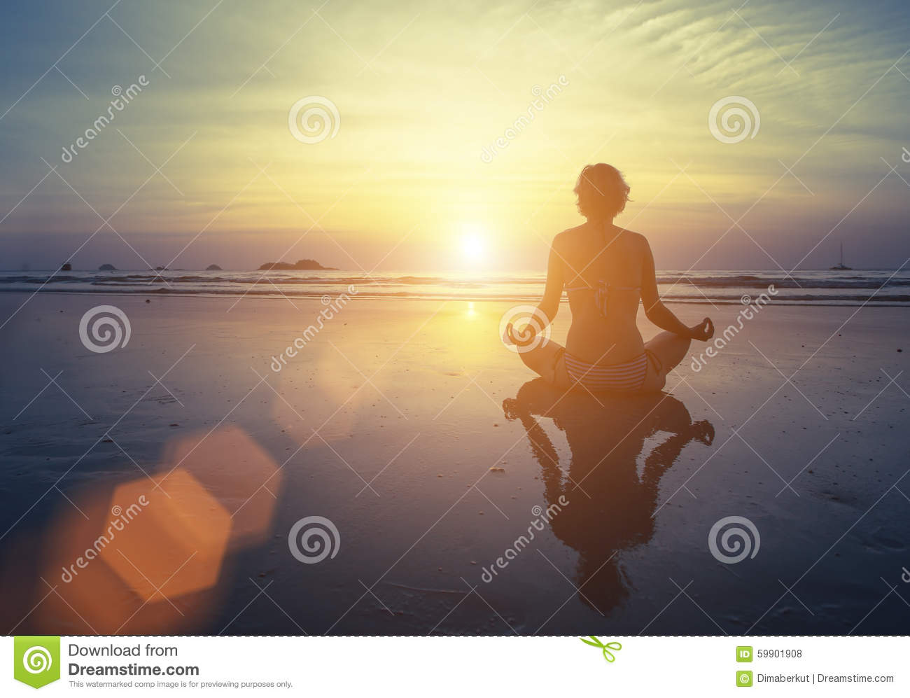 Yoga, fitness and healthy lifestyle. Silhouette meditation girl on the background of the stunning sea and sunset.