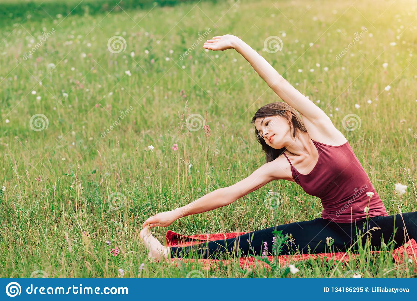 Yoga And Meditation In Nature On A Sunny Day Beautiful Woman In Burgundy Top On The Background Of Fields And Forests Stock Image Image Of Freedom People 134186295