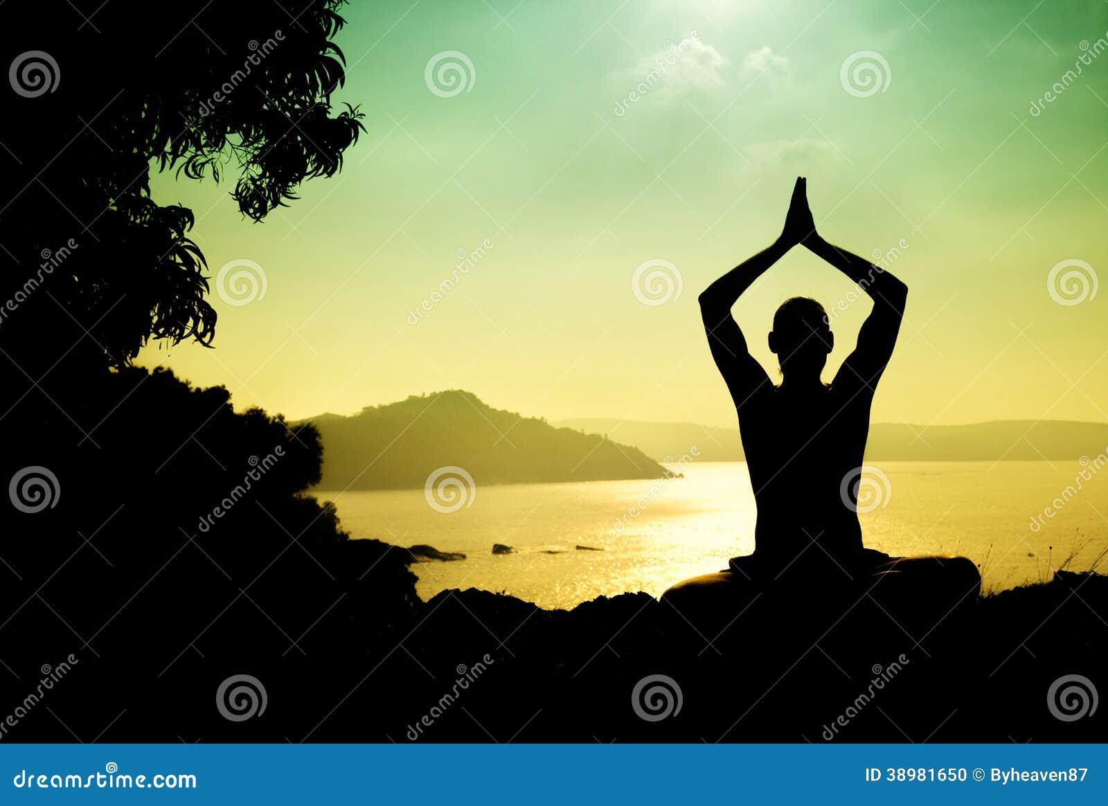 Man silhouette in Yoga meditation pose near the ocean in Gokarna    Yoga Meditation Pose Silhouette
