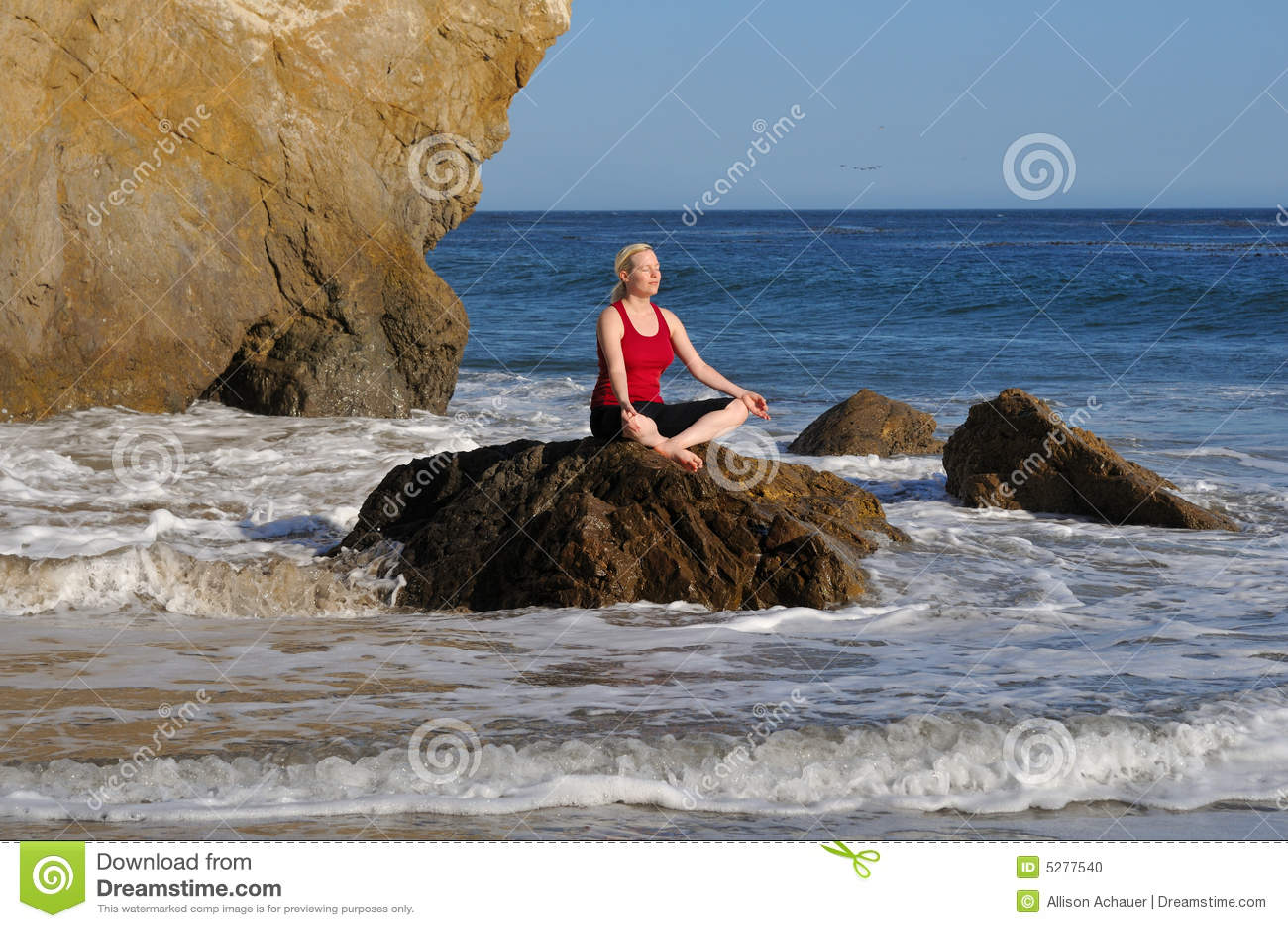 Yoga meditation at sunny beach