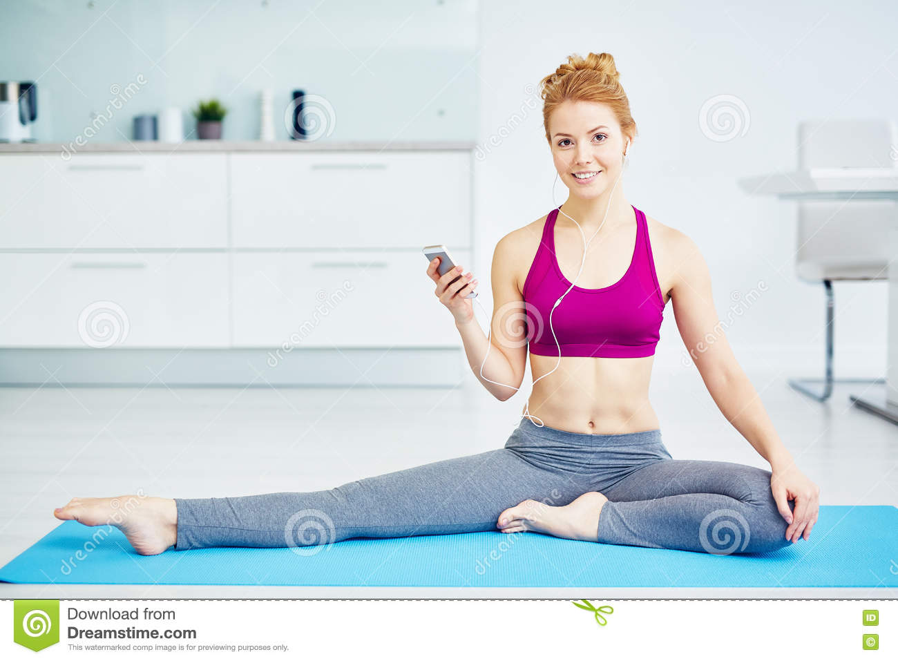 Yoga with music stock image  Image of gadget, floor, happy