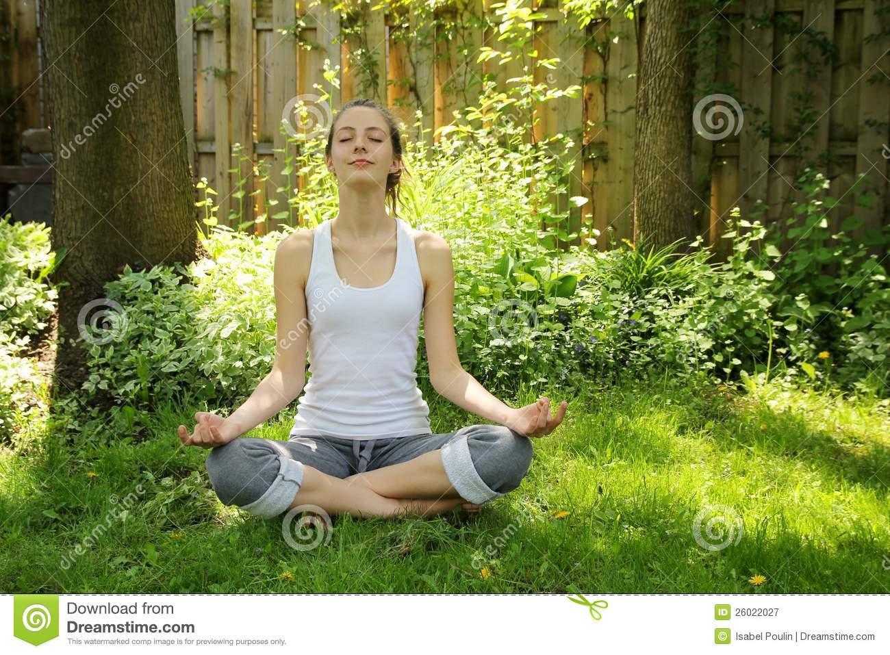 Teenager Relaxing And Doing Yoga In A Nice Quiet Garden