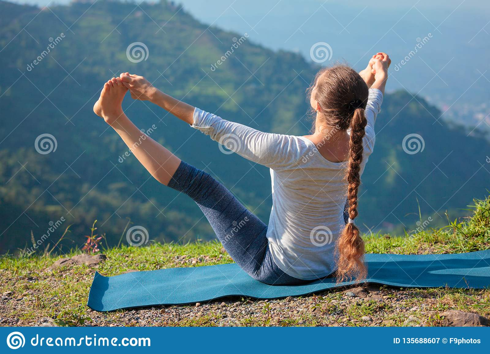 Yoga outdoors in mountains