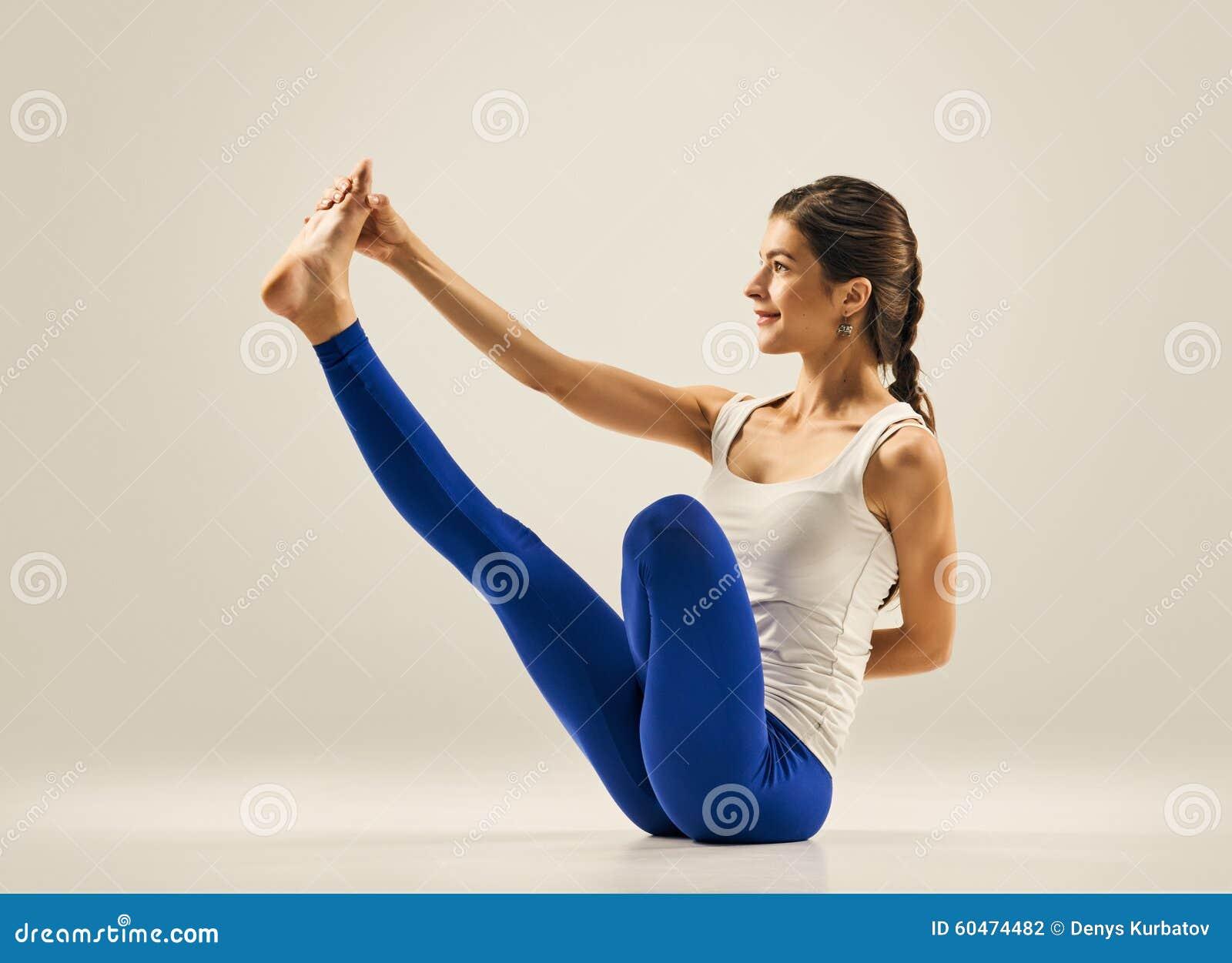 Yoga pose gymnastics seating balance stock photo for Floor yoga poses