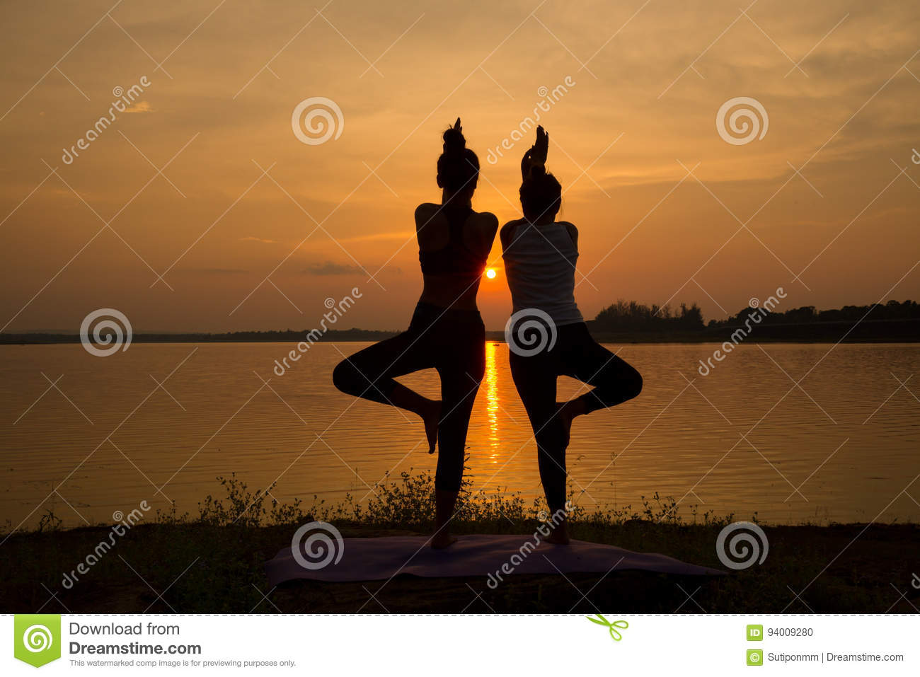 Download YOGA Silhouette Two Woman Practicing Yoga Poses On Sunset Rivers Stock Photo