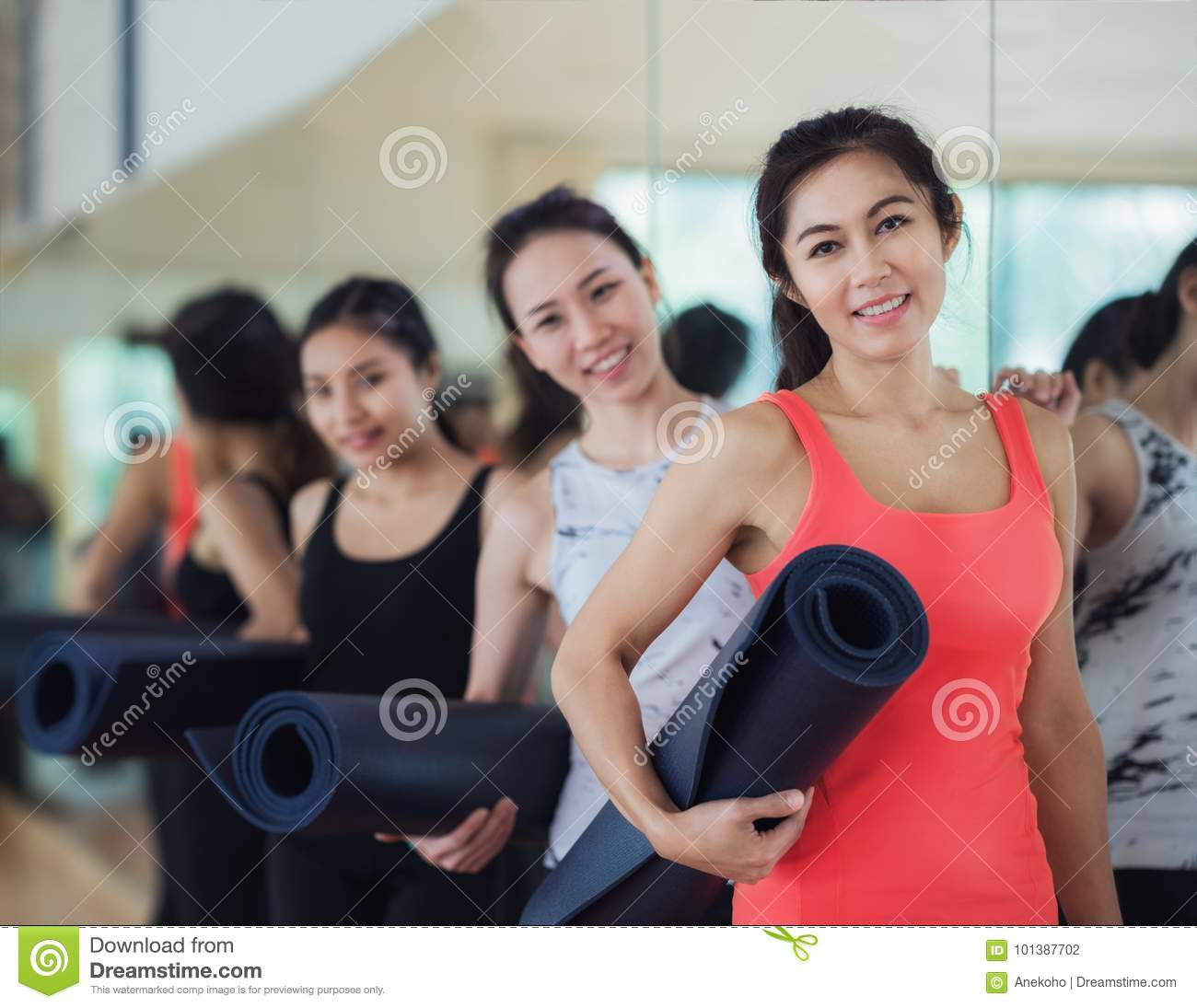 Yoga teacher and her student carry a mat and waiting in fitness
