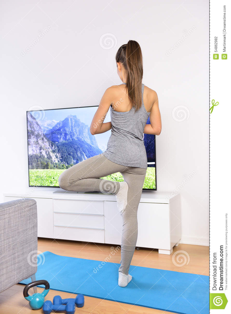 Yoga video woman training in home living room stock photo for Living room yoga
