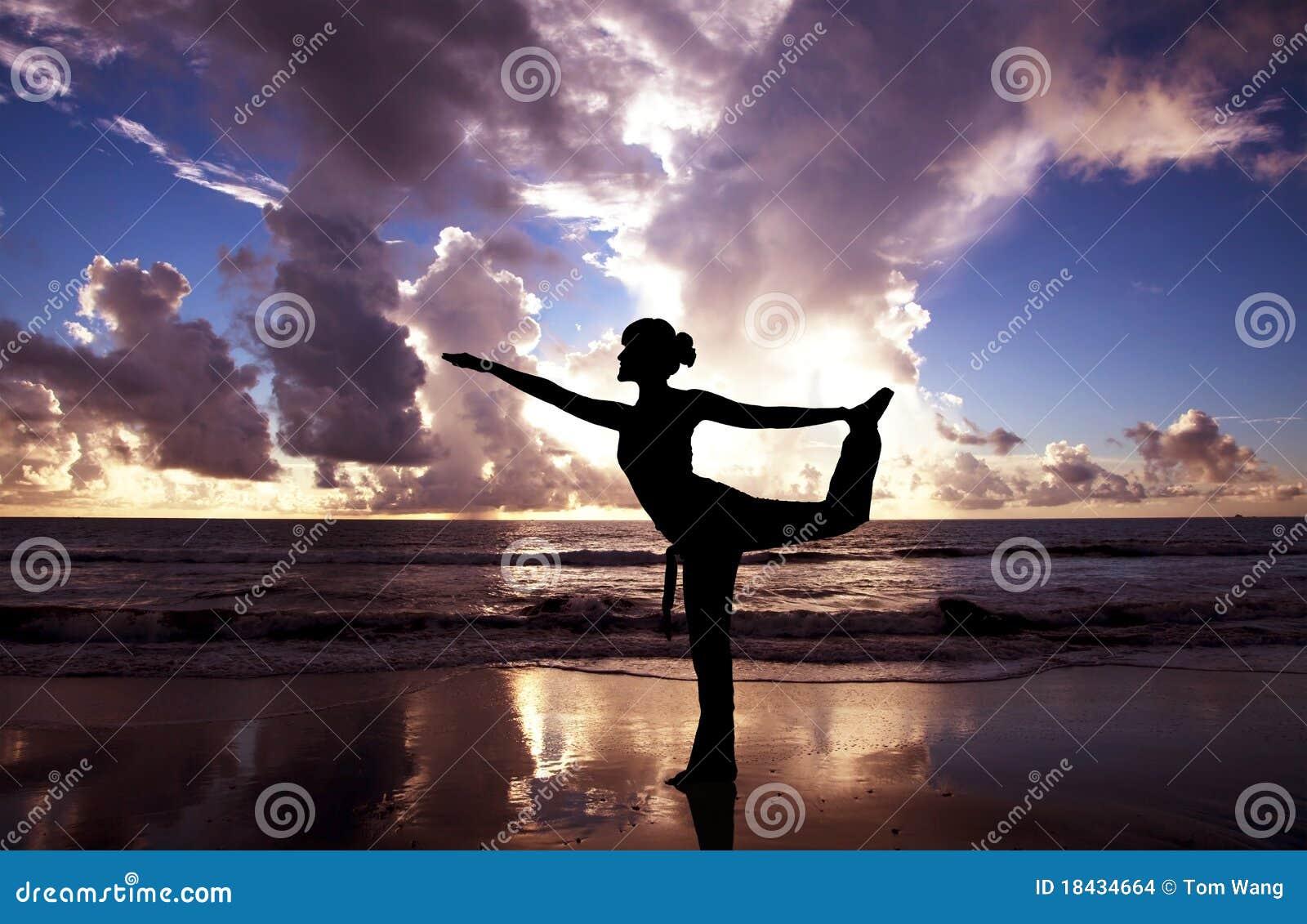 Yoga woman on the beach